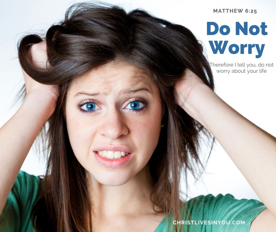 Woman pulls on her hair with a worried look on her face