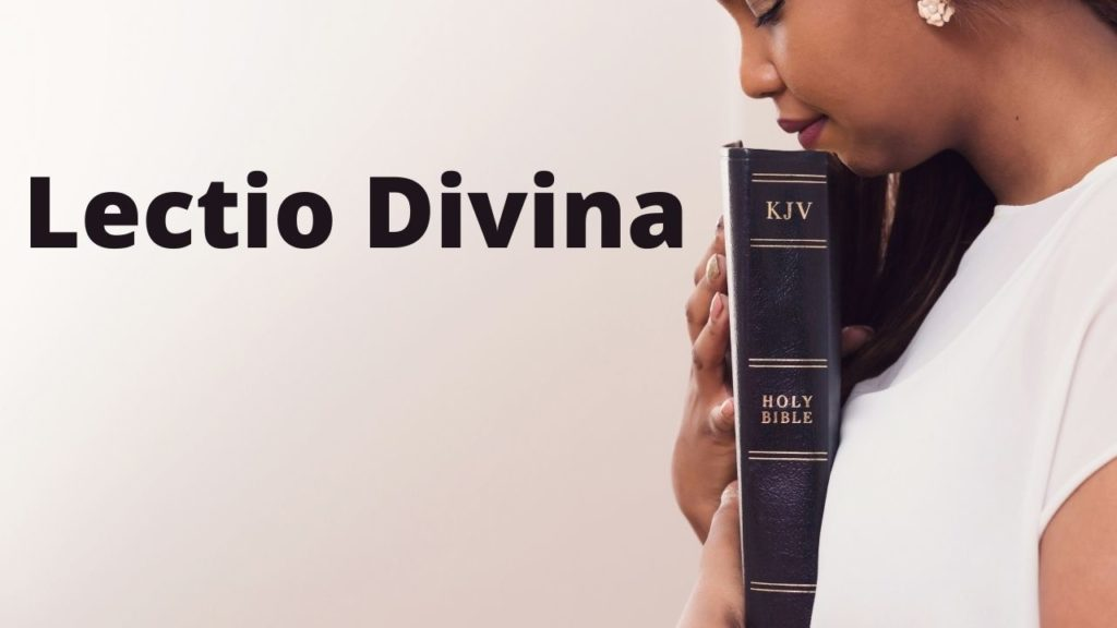 Woman holds a bible with eyes closed