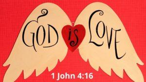 The words from 1 John 4:16 'God is love' written on angel wings.