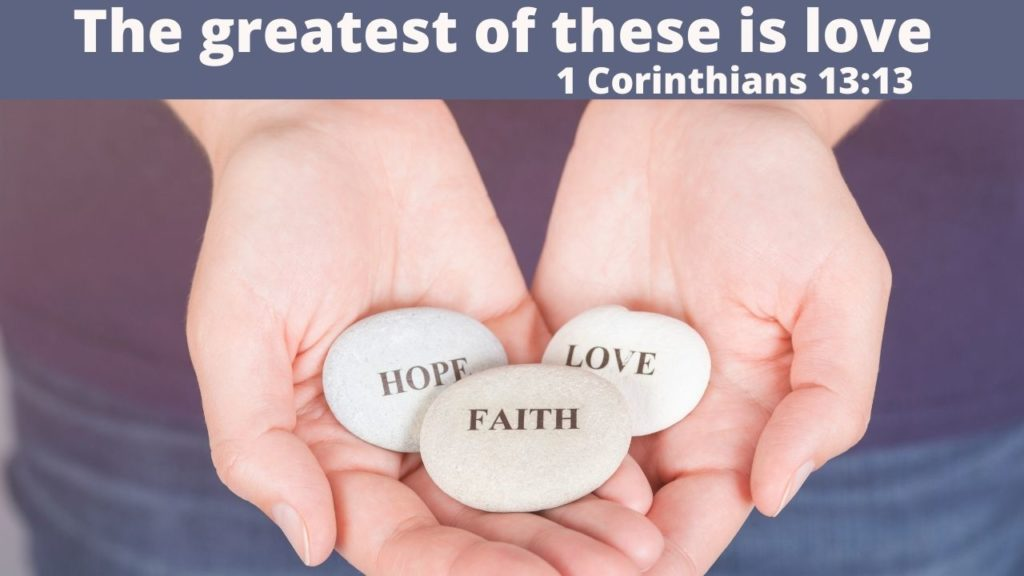 3 rocks held in cupped hands, on the rocks are written: Faith, Hope, Love