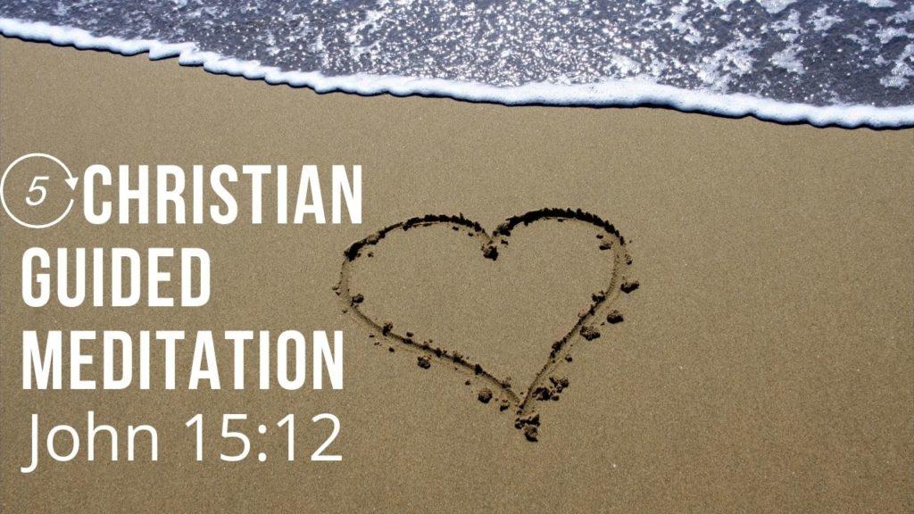 A heart drawn in the sand near the ocean