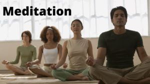 People sit to meditate with their eyes closed